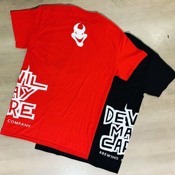 Two DMC-branded T-shirts facing back