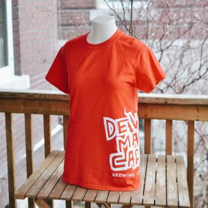 Red DMC logo tee on a manakin torso