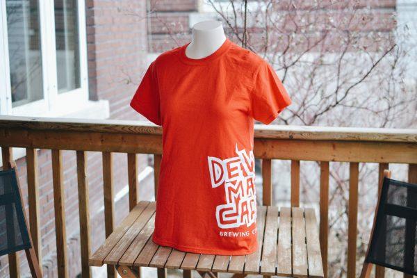 Red DMC logo tee on a manakin torso