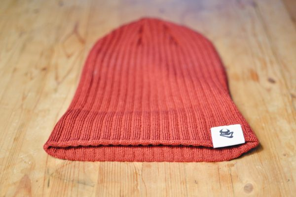 Crimson red toque with Beelzebeer logo showing uncuffed
