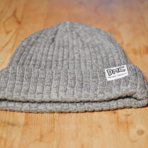Heather grey toque with DMC logo tag on the cuff